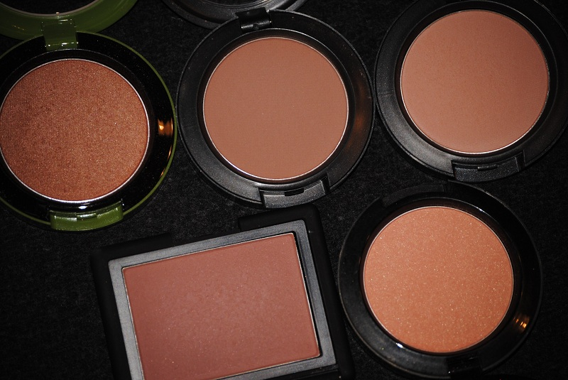 Buy a pink or tan blush if you have olive skin
